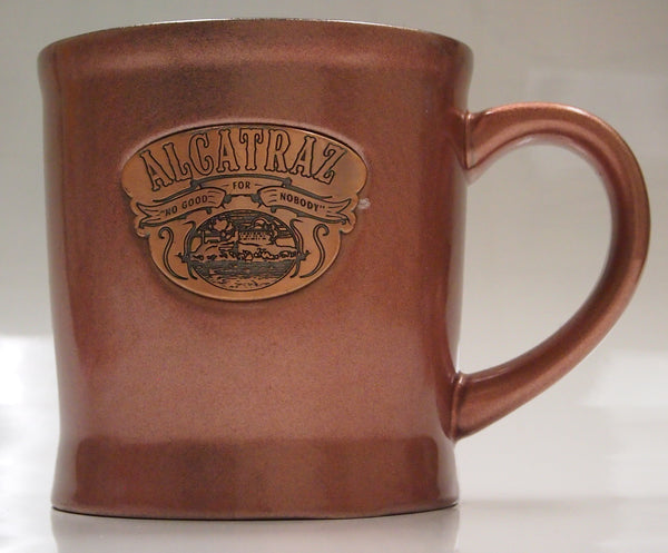 Large Copper Color Ceramic Coffee Mug, with a Alcatraz badge on its side.