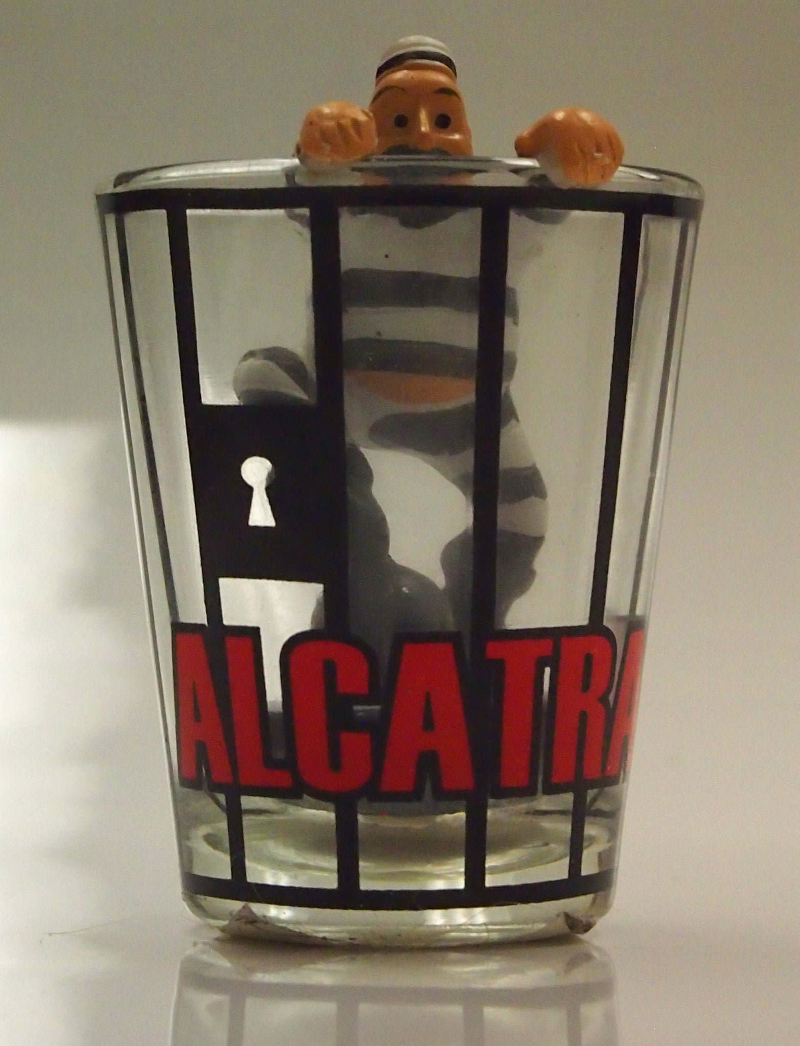 Shot Glass with escaping prisoner
