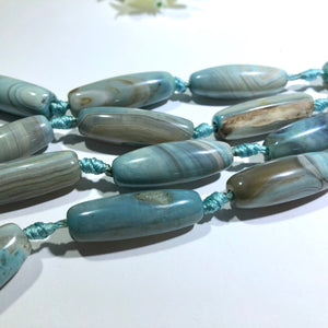 "Sky Blue Oval Tube Natural Agate Strand, 14"" Strand"