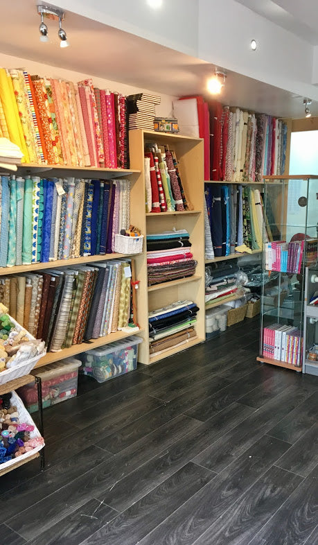shelves of cotton fabrics in many colours and designs