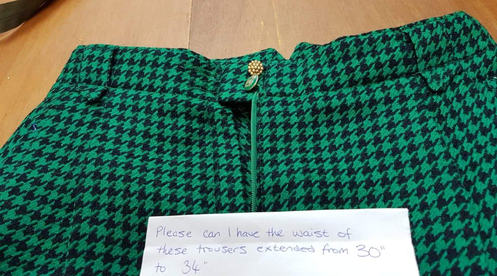 vintage green and black houndstooth wool trousers that need an alteration