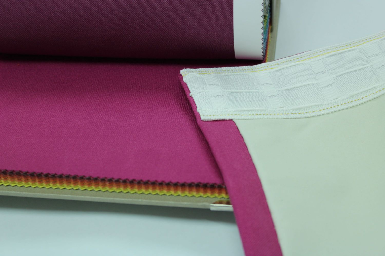 swatch book with pink fabric and finish on pink curtain