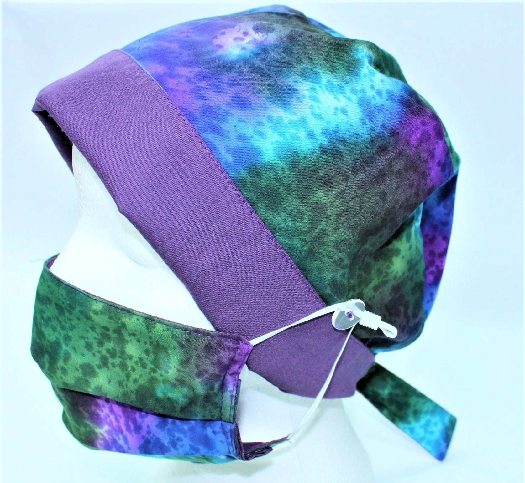 Scrub cap with matching facemask in purple'green and turquoise cotton batik