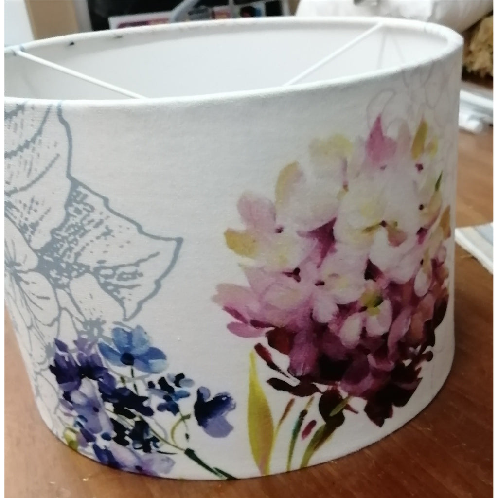handmade lampshade with cerise and purple hydrangea on white background fabric