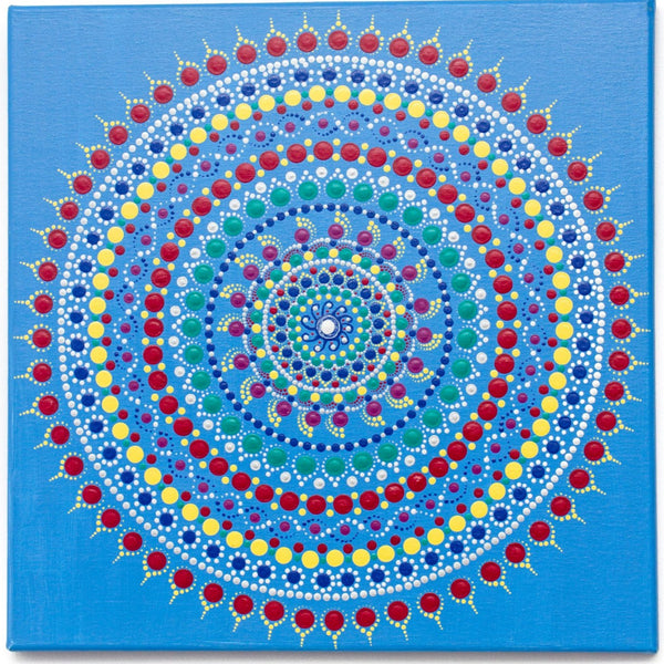 Colourful dot mandala on blue background, red yellow green purple white