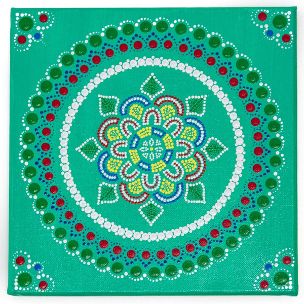 Dot mandala, red green yellow blue on green background