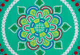 Dot mandala detail, red green yellow blue on green background