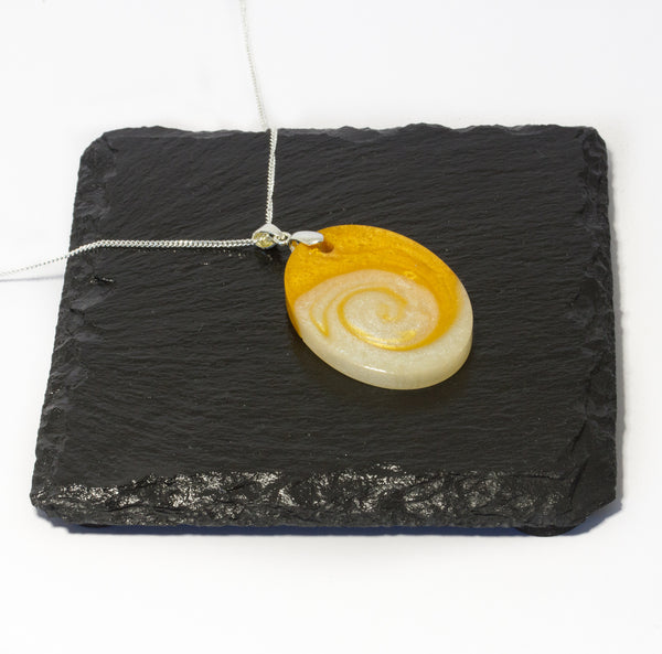 Gold and white swirl resin pendant with sterling silver necklace