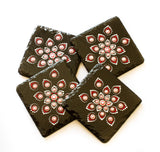 Black slate coasters decorated with red white silver dots
