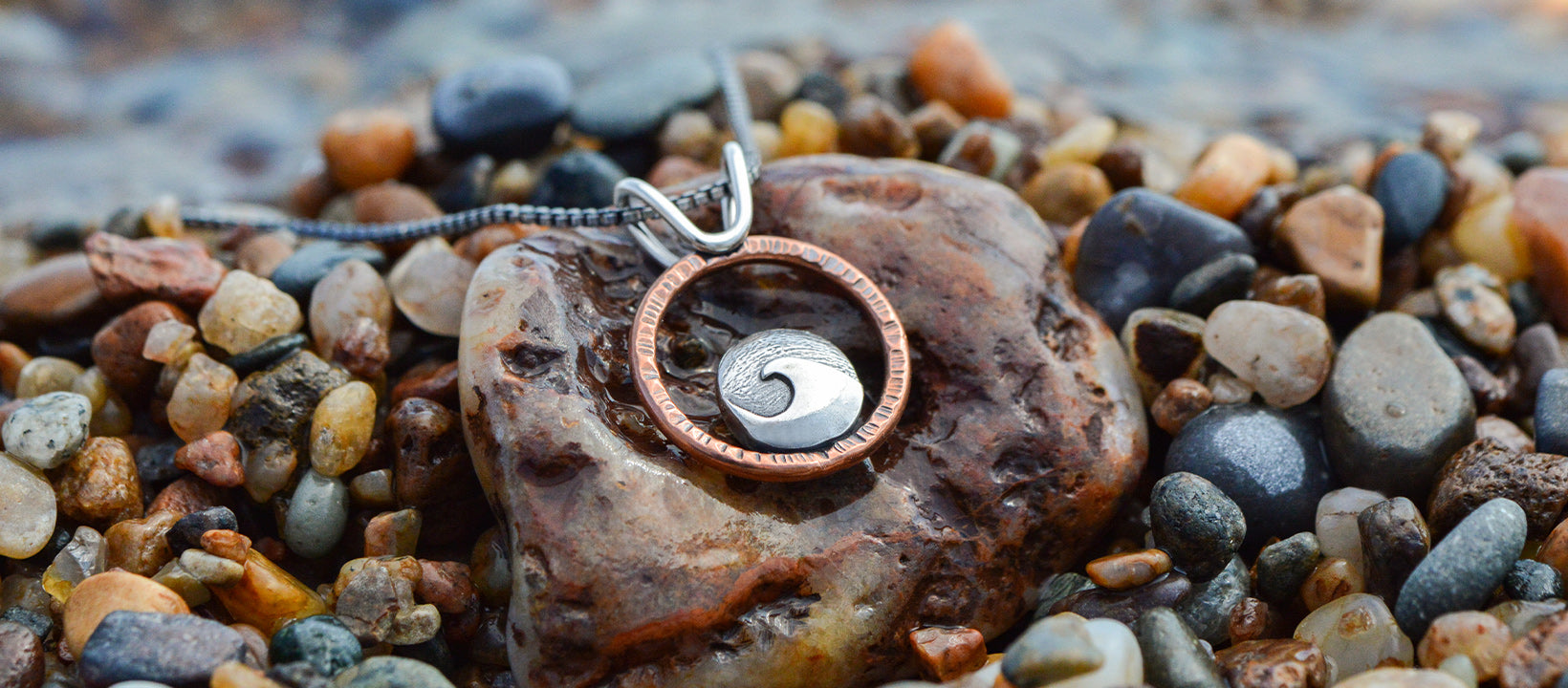 mixed metal pendant with cresting wave handmade in MIchigan by Beth Millner Jewelry