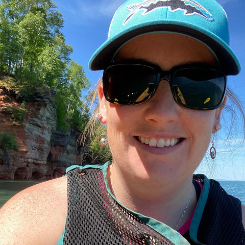 Grace kayaking at Pictured Rocks wearing Mini Cresting Wave Earrings