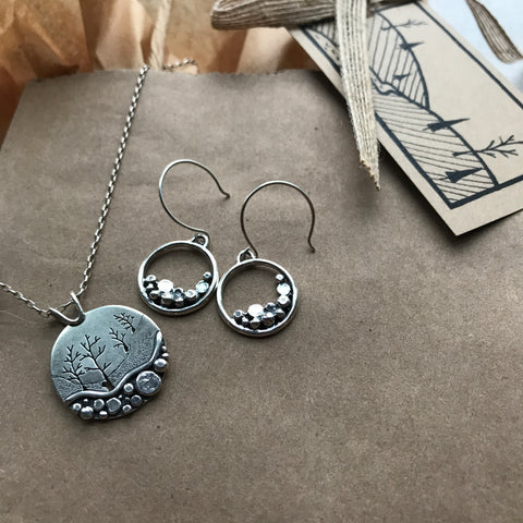 frosted pebble trail pendant and simple pebble earrings linking to the pebble collection by beth millner jewelry