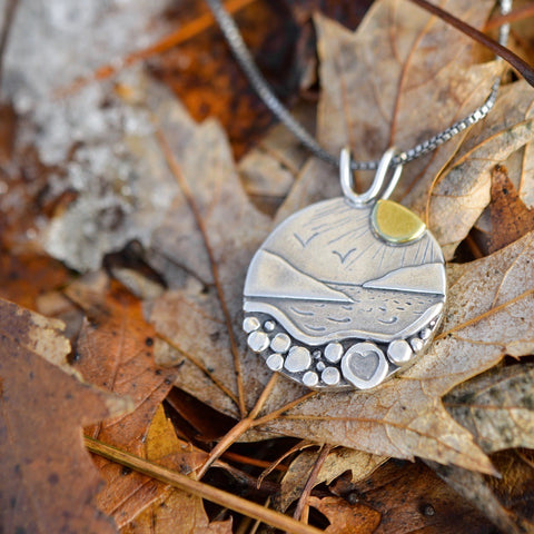 Reversible, mixed metal Celestial Lovers Pendant featuring sun and moon by Beth Millner Jewelry
