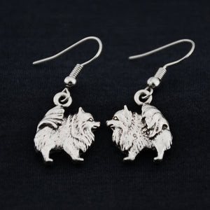Pom charm earrings