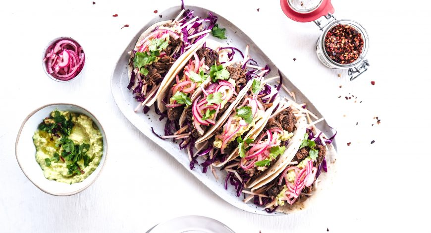 Slow Cooked Chipotle Beef Tacos with Apple and Cabbage Slaw, Guacamole and Pickled Onion