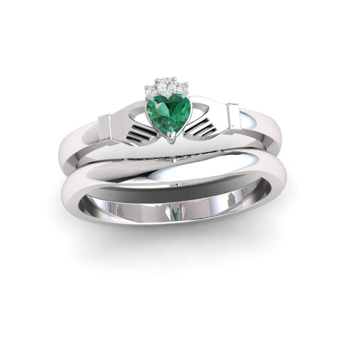 Emerald and diamond claddagh ring with gently curved wedding ring.