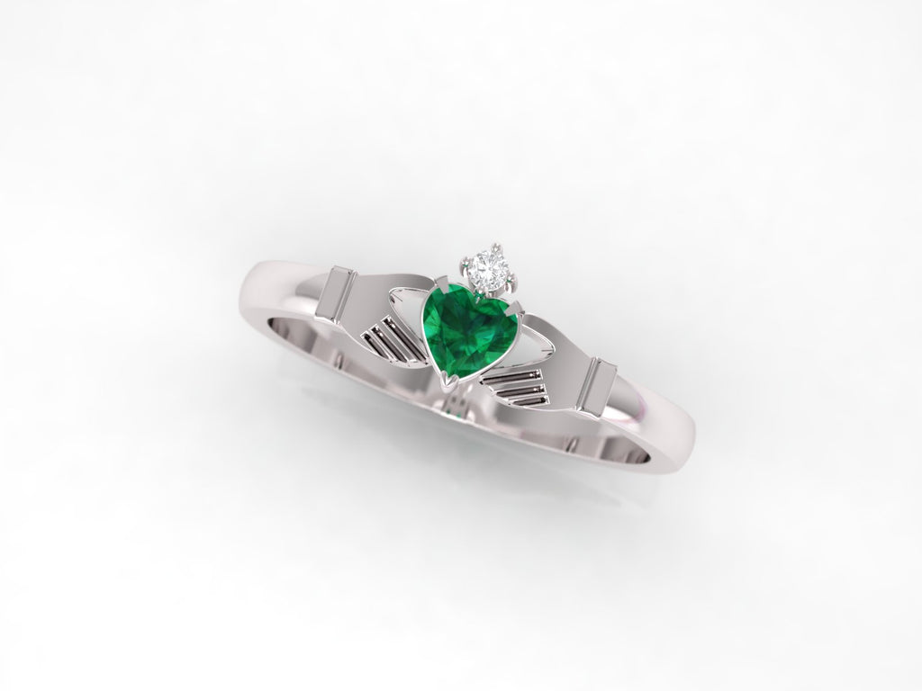 Claddagh ring. Emerald and diamond claddagh ring. Gold claddagh ring.