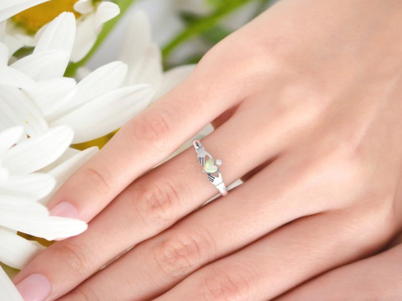 opal claddagh ring on finger