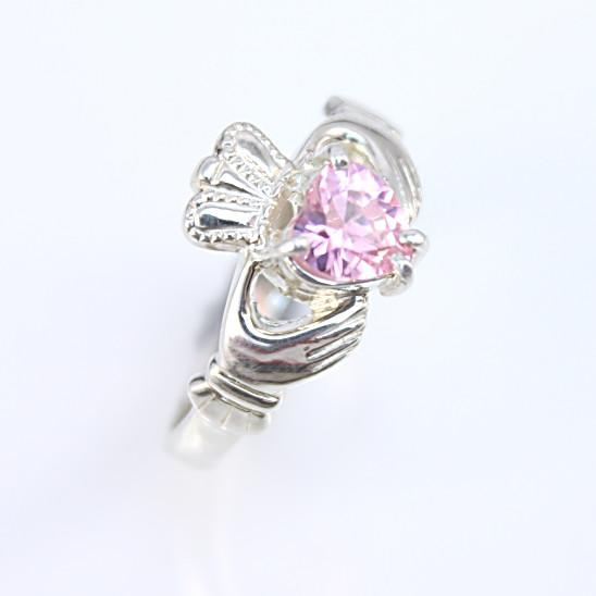 Jewelry - Claddagh Ring, Ladies Silver Claddagh Ring, Set With Sparkling Pink Cubic Zirconia Stone.