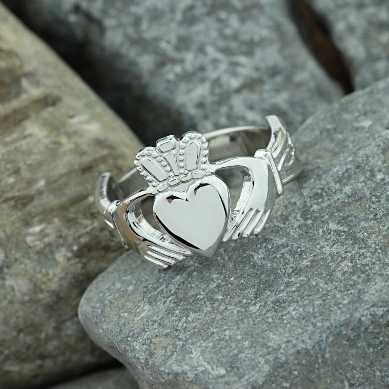 Claddagh ring, Mens silver Claddagh ring with celtic engraved cuffs ...