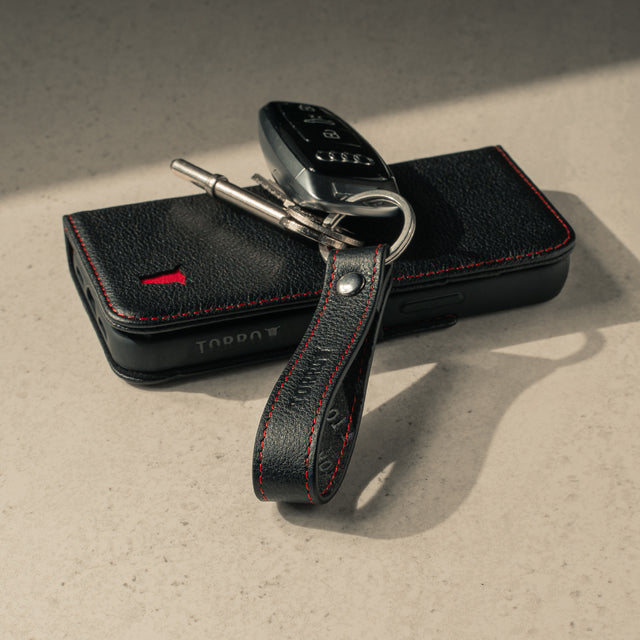 Black Leather (with red stitching) keyring with matching TORRO phone case