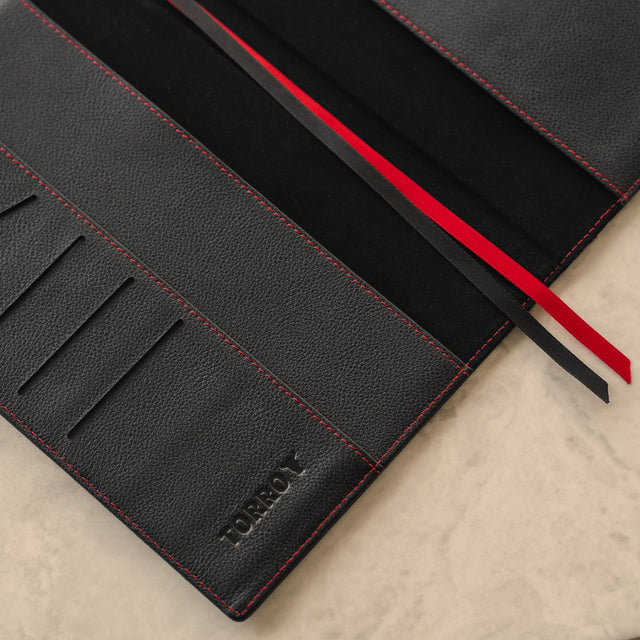Close up of the inside cover of the Black Leather (with Red Stitching) A5 Notebook Cover