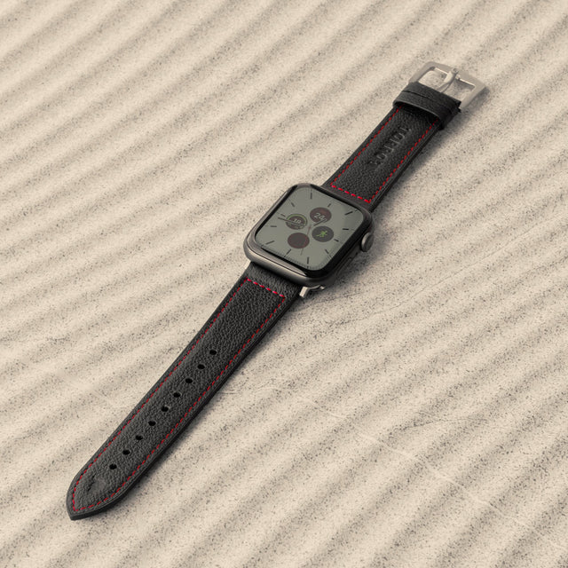 Black Leather Strap (with Red Stitching) attached to an Apple Watch