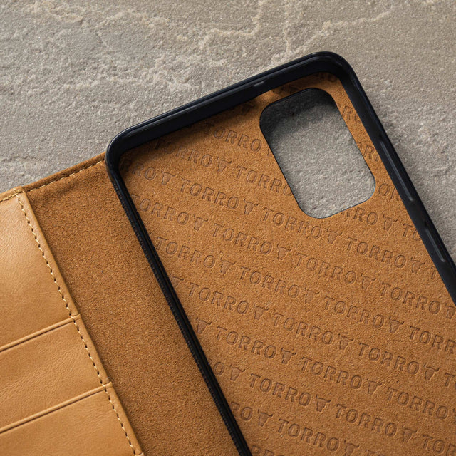 Close up of the TORRO branded microfibre lining in the Tan Leather Stand Case for Galaxy S20 / S20 5G
