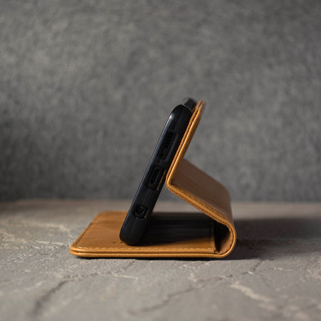 Demonstrating the built in stand function of the Tan Leather Stand Case for Galaxy S20 / S20 5G