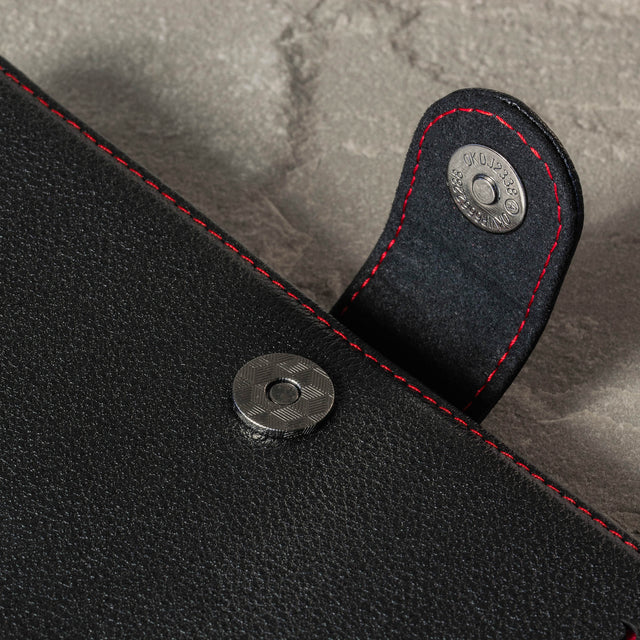 Close up of the magnetic clasp closure on the Black Leather (with Red Stitching) Wallet Case for Galaxy S20 Plus