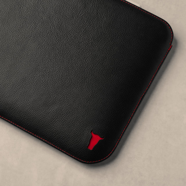 Close up of logo on the Black with Red Detail Leather iPad Sleeve