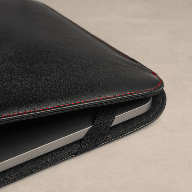 Elasticated holders on the Black with Red Detail Leather Sleeve to keep the iPad secure