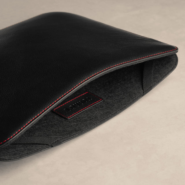 Wool felt lining of the Black with Red Detail Leather iPad Sleeve