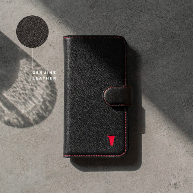 Highlighting the genuine leather used to make the Black Leather (with Red Stitching) Wallet Case for iPhone 11