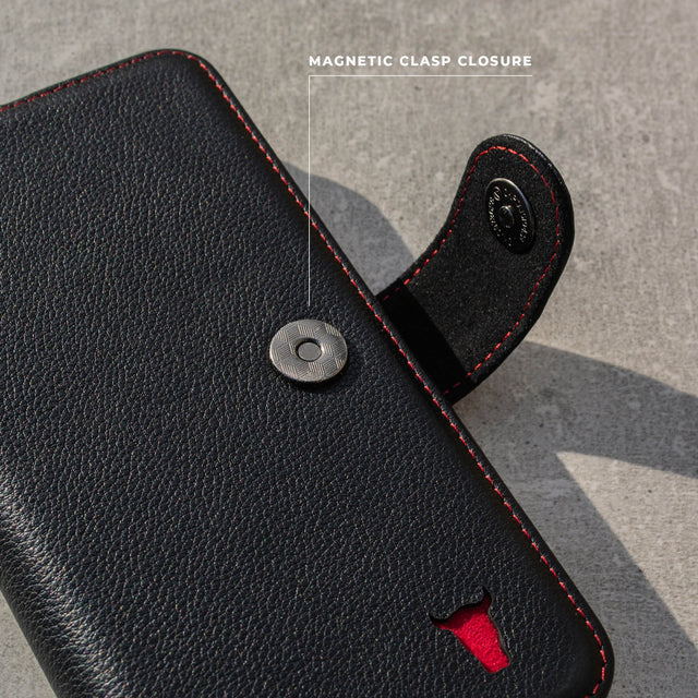 Highlighting the magnetic clasp closure on the Black Leather (with Red stitching) Wallet Case for  iPhone 11 Pro