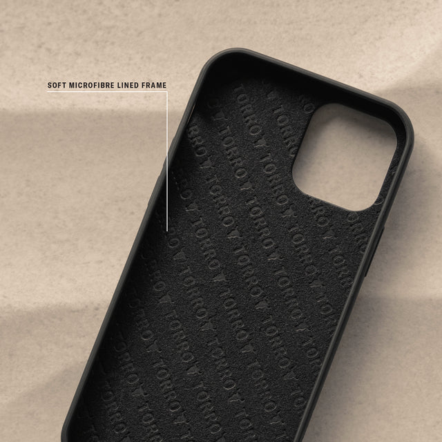 Highlighting the microfibre lining on the Black Leather (with Red Stitching) Back Bumper Case for iPhone 12 Pro Max