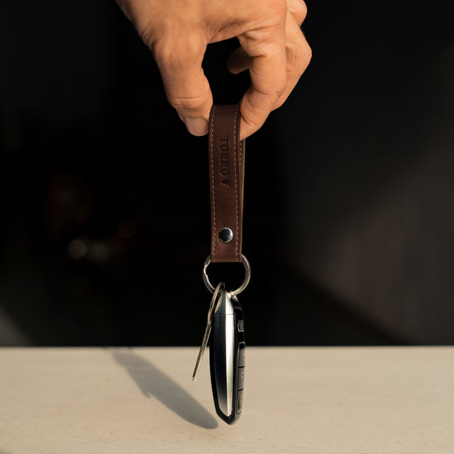 Highlighting the unnecessary bulk the Dark Brown Leather Keyring adds to keys