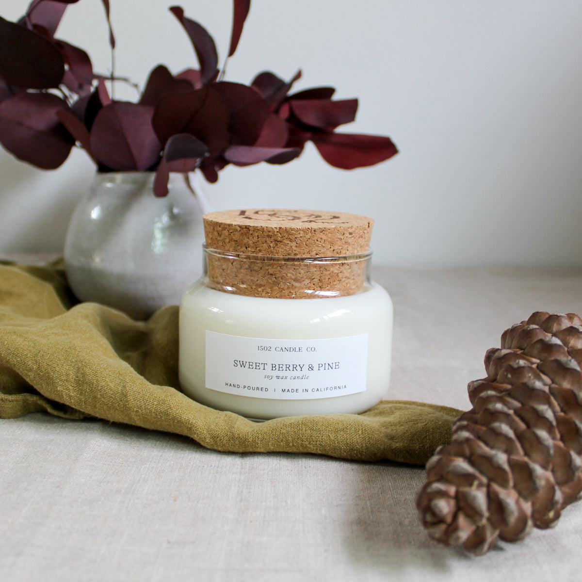 Sweet Berry & Pine holiday candle.