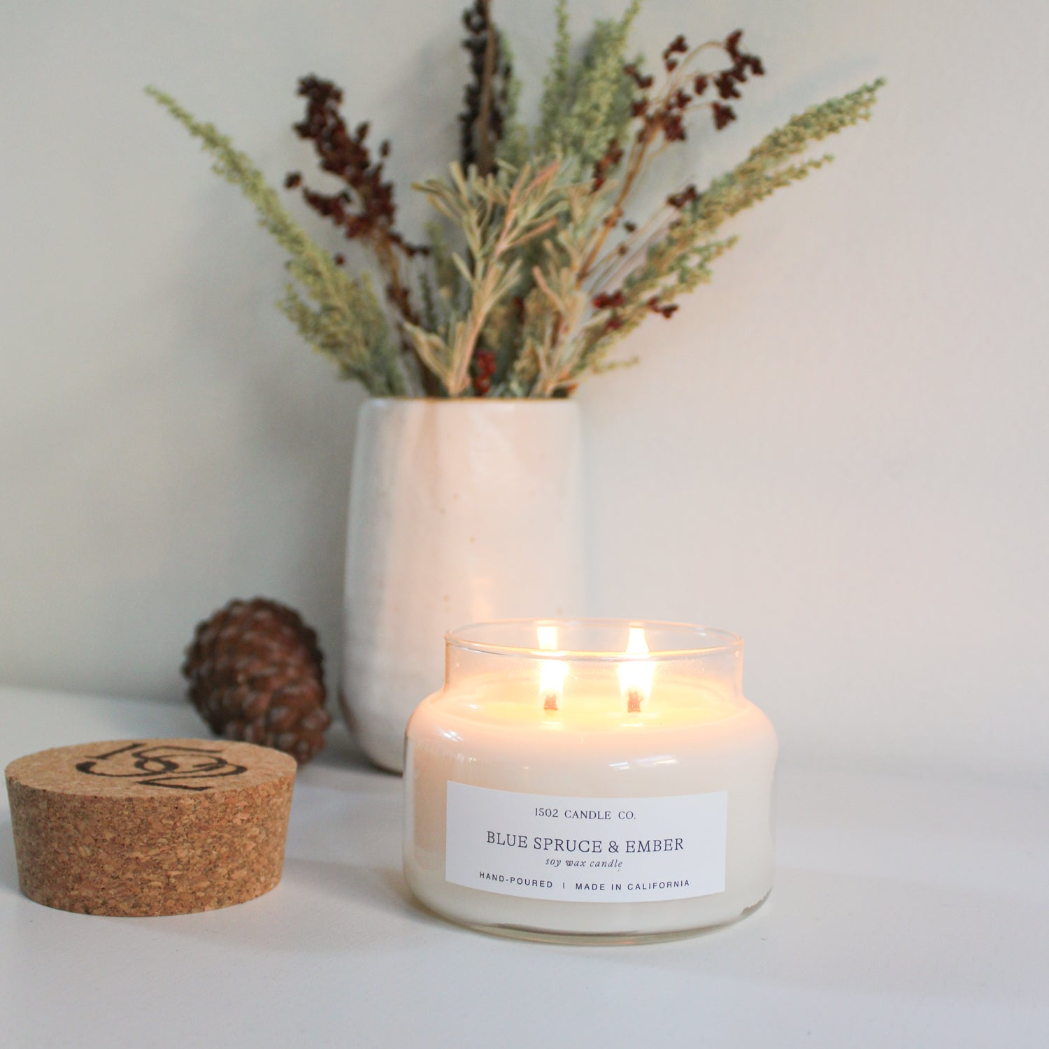 Blue spruce and ember candle for the holidays.