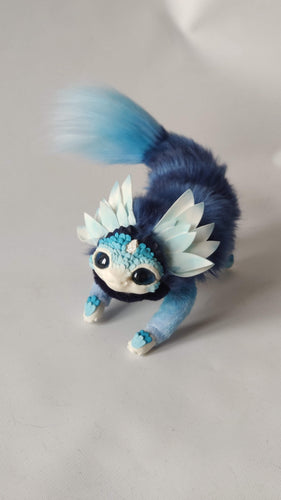 Blue wingless baby dragon
