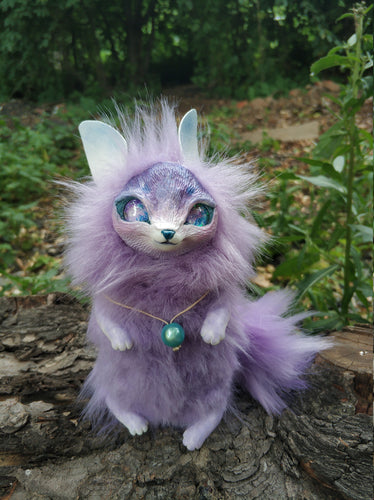 Purple cat-fox poseable art toy