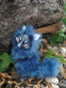 Blue cat-fox poseable art toy