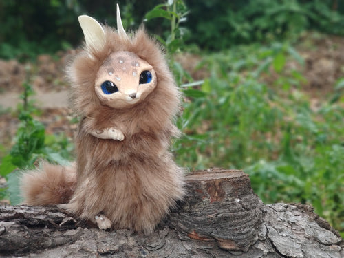 Beige cat-fox poseable art toy