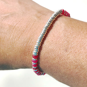 Ruby Jade rondelle stretch bracelet with silver spacers