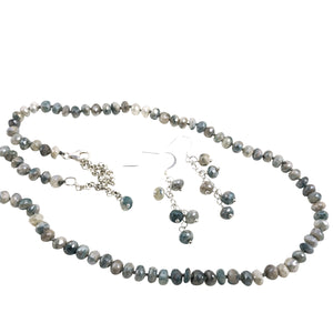 Exquisite and Exclusive!!! This Mystic coated White Sapphire hand knotted necklace/earring set is a rare treasure.
