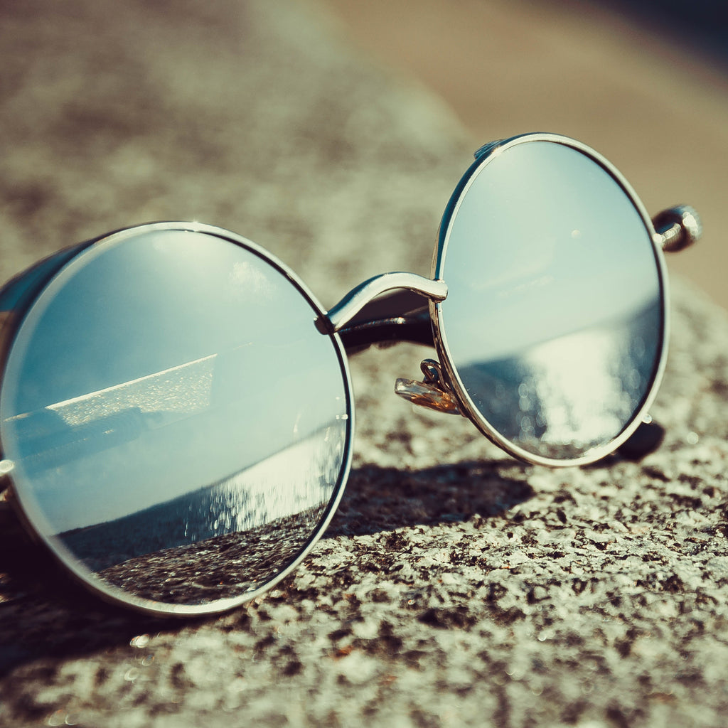 Silver Framed Hippie Sunglasses on Concrete