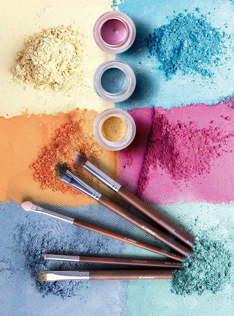 colored eyeshadow powder and makeup brushes