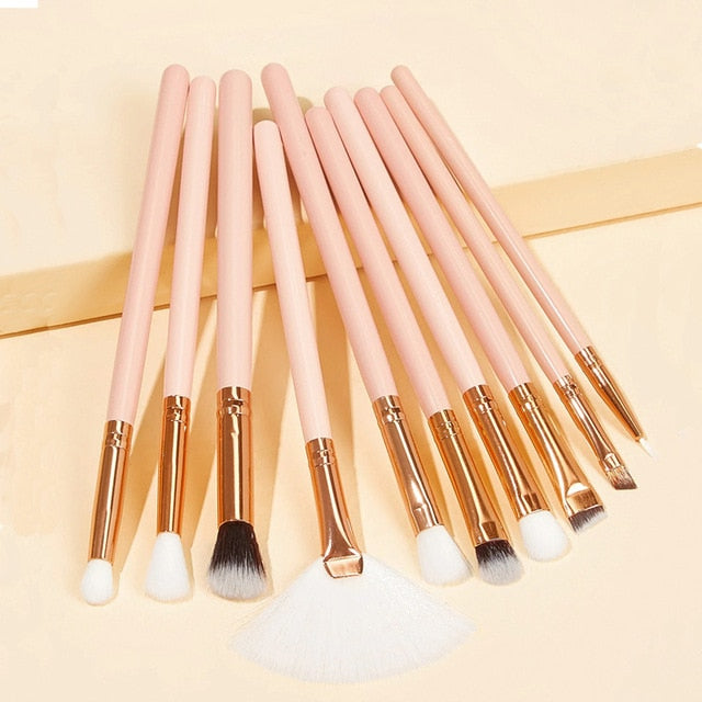 light pink and gold makeup brushes