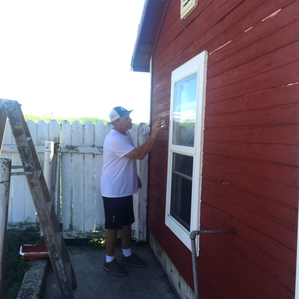Anthony painting chicken coop