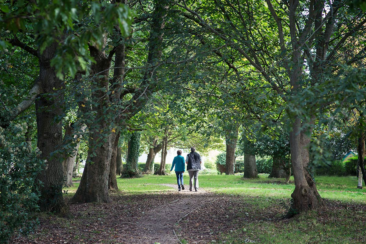 Mum and dad walking through the park